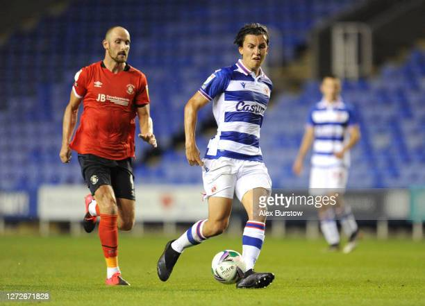 Tom McIntyre of Reading FC passes the ball whilst under pressure from Danny Hylton of Luton Town during Carabao Cup Second Round match between...