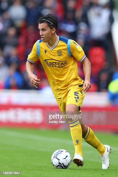 Tom McIntyre of Reading FC runs with the ball during the Sky Bet Championship match between Stoke City and Reading at Bet365 Stadium on August 07,...