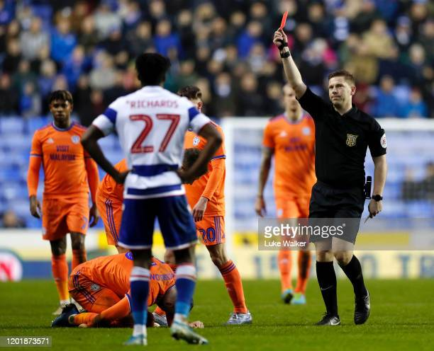 Tom McIntyre of Reading is shown a red card by Marc Edwards during the FA Cup Fourth Round match between Reading FC and Cardiff City at Madejski...