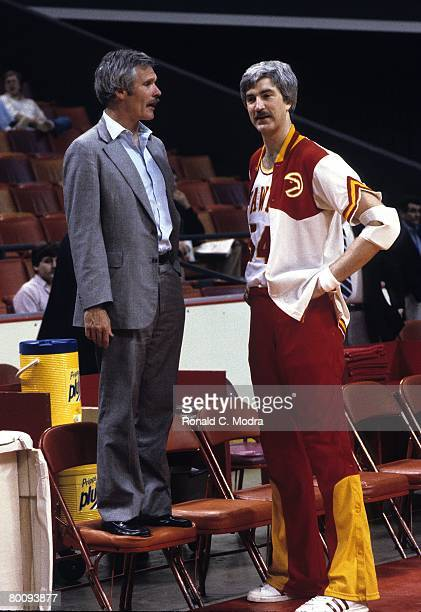 Tom McMillan of the Atlanta Hawks talking with owner Ted Turner prior to a game against the Utah Jazz in April 1982 in Atlanta Georgia