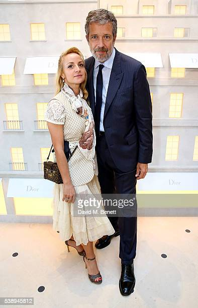 Tom Meggle and guest attend the opening of the House Of Dior on New Bond Street on June 8 2016 in London England