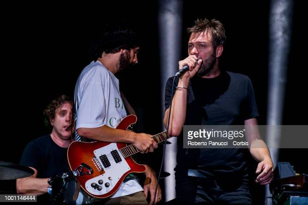 Tom Meighan and his group Kasabian performs on stage on July 15 2018 in Naples Italy