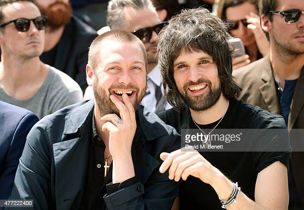 Tom Meighan and Serge Pizzorno sit in the front row at Burberry Menswear Spring/Summer 2016 show at Kensington Gardens on June 15 2015 in London...