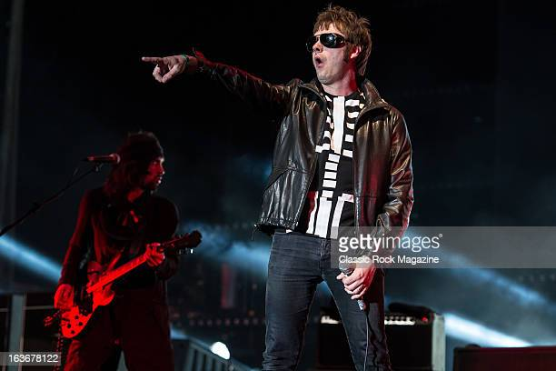 Tom Meighan and Sergio Pizzorno of British indie rock band Kasabian performing live onstage at Reading Festival, August 25, 2012.