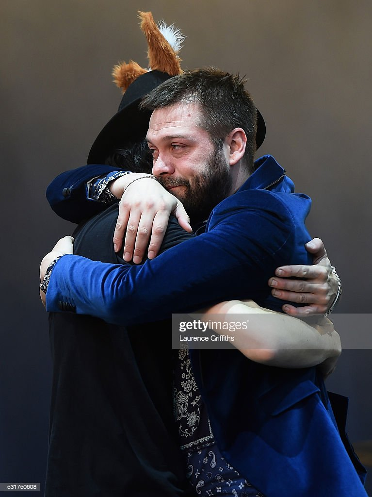 Tom Meighan and Sergio Pizzorno of Kasabian perform during the Leicester City Barclays Premier League winners bus parade on May 16, 2016 in Leicester, England.