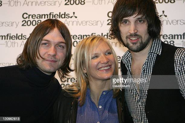 Tom Meighan and Sergio Pizzorno of the Kasabian pose with Jo Whiley of Radio One during the launch of Creamfields 2008 in the Korova Bar on March 7...
