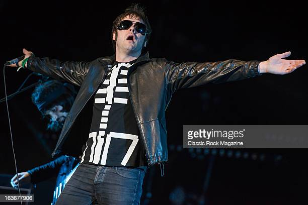 Tom Meighan of British indie rock band Kasabian performing live onstage at Reading Festival, August 25, 2012.