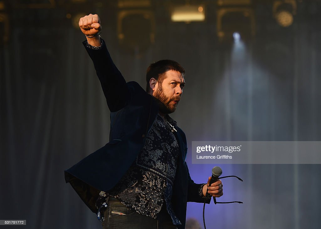 Tom Meighan of Kasabian performs during the Leicester City Barclays Premier League winners bus parade on May 16, 2016 in Leicester, England.