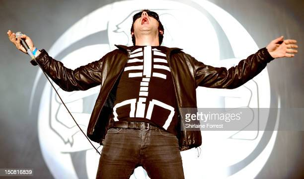 Tom Meighan of Kasabian performs headling the Main Stage on day three of Leeds Festival at Bramham Park on August 26 2012 in Leeds England