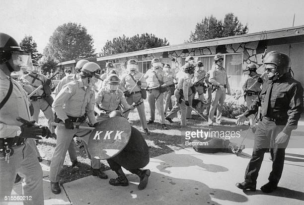 Tom Metzger leader of the California Ku Klux Klan orders members to withdraw after a brief clash with police here on March 15 1980 Just behind him is...