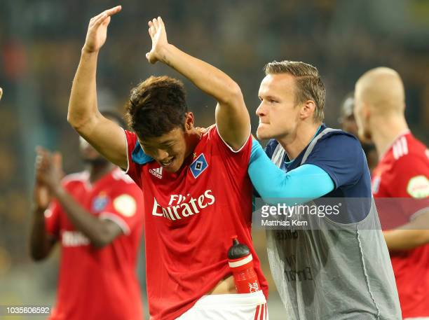 Tom Mickel and Hee Chan Hwang of Hamburg show their delight after winning the Second Bundesliga match between SG Dynamo Dresden and Hamburger SV at...