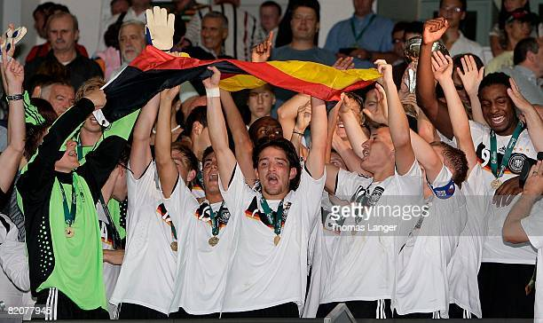 Tom Mickel, Ron Robert Zieler, Marcel Risse, Danny Latza, Deniz Naki, Sven Bender, Timo Gebhart and Florian Jungwirth of Germany celebrate after the...