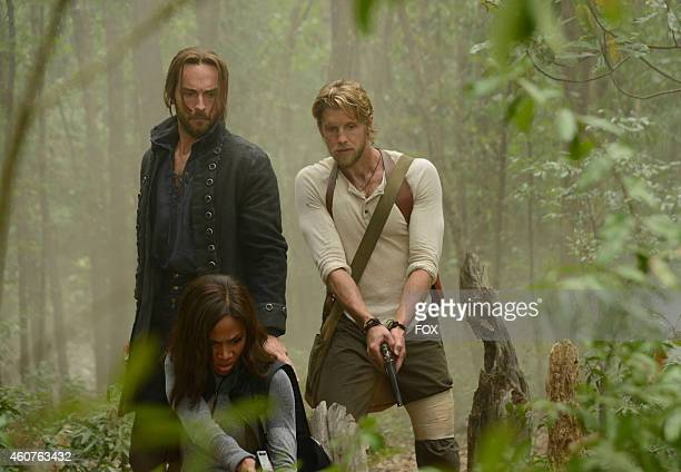 Tom Mison Nicole Beharie and Matt Barr in the 'Go Where I Send Thee' episode of SLEEPY HOLLOW airing Monday Oct 13 2014 on FOX