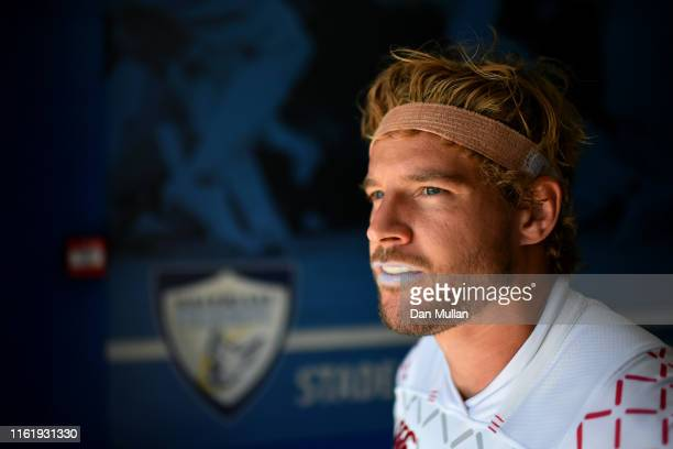Tom Mitchell of England prepares to lead his team onto the field during the Cup Quarter Final match between England and Italy on day two of the Mens...