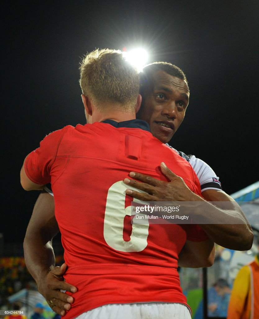 Tom Mitchell of Great Britain embraces Osea Kolinisau of Fiji following the Men's Rugby Sevens Gold Medal match between Fiji and Great Britain on day six of the Rio 2016 Olympic Games at Deodoro Stadium on August 11, 2016 in Rio de Janeiro, Brazil.