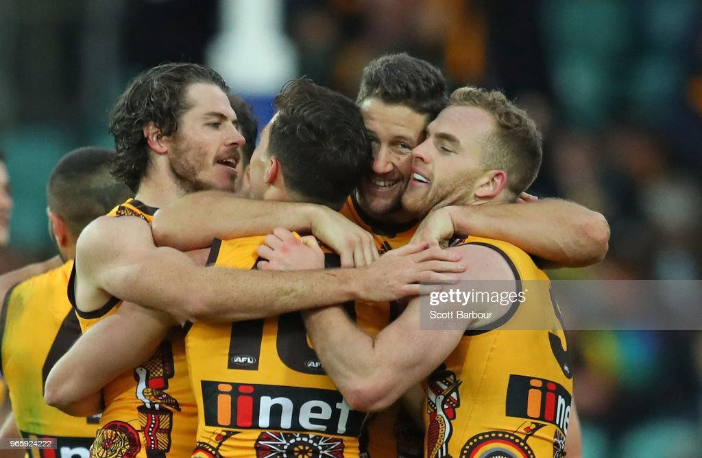 Tom Mitchell of the Hawks and Isaac Smith of the Hawks celebrate at the final siren during the round 11 AFL match between the Hawthorn Hawks and the Port Adelaide Power at University of Tasmania Stadium on June 2, 2018 in Launceston, Australia.