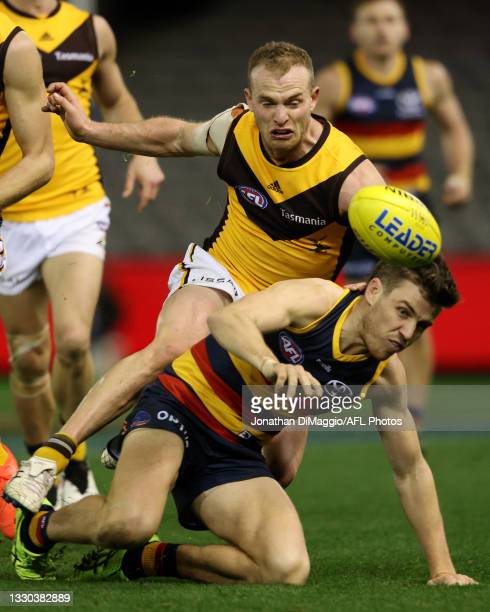 Tom Mitchell of the Hawks and Paul Seedsman of the Crows contest for the ball during the round 20 AFL match between Adelaide Crows and Hawthorn Hawks...