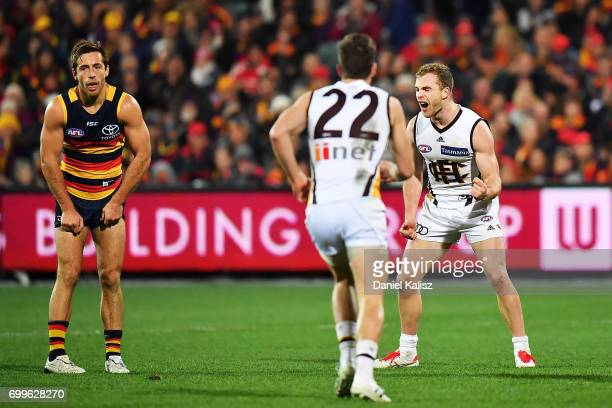 Tom Mitchell of the Hawks celebrates after kicking a goal during the round 14 AFL match between the Adelaide Crows and the Hawthorn Hawks at Adelaide...