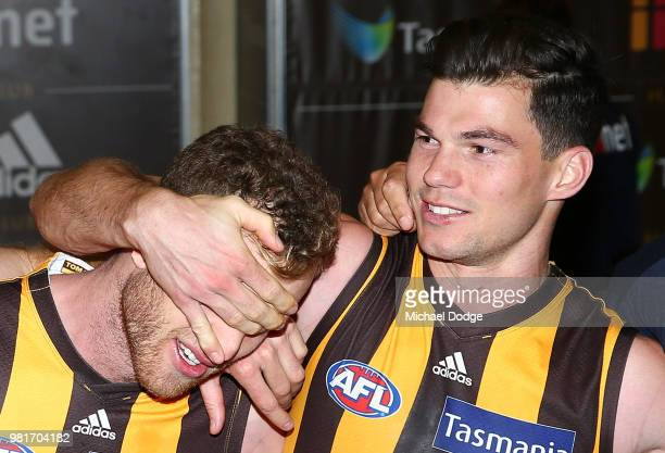 Tom Mitchell of the Hawks celebrates the win in his 100th match with Jaeger O'Meara during the round 14 AFL match between the Hawthorn Hawks and the...