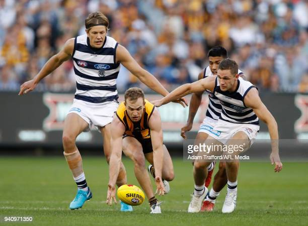 Tom Mitchell of the Hawks in action ahead of Rhys Stanley Tim Kelly and Joel Selwood of the Cats during the 2018 AFL round 02 match between the...