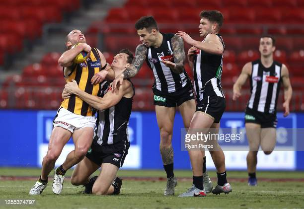 Tom Mitchell of the Hawks is tackled by Brody Mihocek of the Magpies during the round 6 AFL match between the Collingwood Magpies and the Hawthorn...