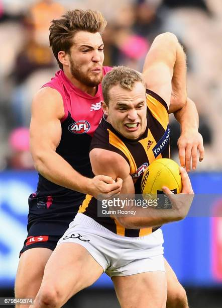 Tom Mitchell of the Hawks is tackled by Jack Viney of the Demons during the round seven AFL match between the Melbourne Demons and the Hawthorn Hawks...