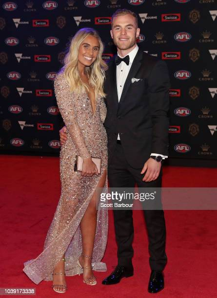 Tom Mitchell of the Hawks poses with his partner Hannah Davis as they arrive ahead of the 2018 Brownlow Medal at Crown Entertainment Complex on...