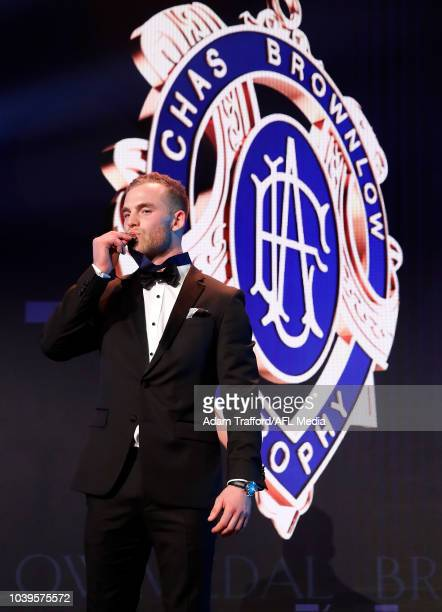 Tom Mitchell of the Hawks poses with the Brownlow Medal during the 2018 Brownlow Medal Count at Crown Palladium on September 24, 2018 in Melbourne,...