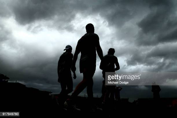 Tom Mitchell of the Hawks walks out as a storm whips through in the background during a Hawthorn Hawks AFL training session on February 14 2018 in...