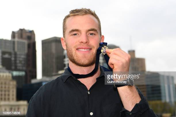 Tom Mitchell of the Hawthorn Hawks poses with the 2018 Brownlow Medal at Crown Entertainment Complex on September 25, 2018 in Melbourne, Australia.