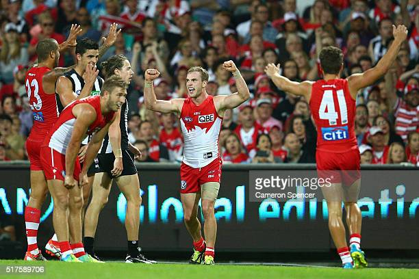 Tom Mitchell of the Swans celebrates kicking a goal with team mates during the round one AFL match between the Sydney Swans and the Collingwood...
