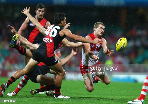 Tom Mitchell of the Swans handballs during the round ten AFL match between the Sydney Swans and the Eseendon Bombers at the Sydney Cricket Ground on...