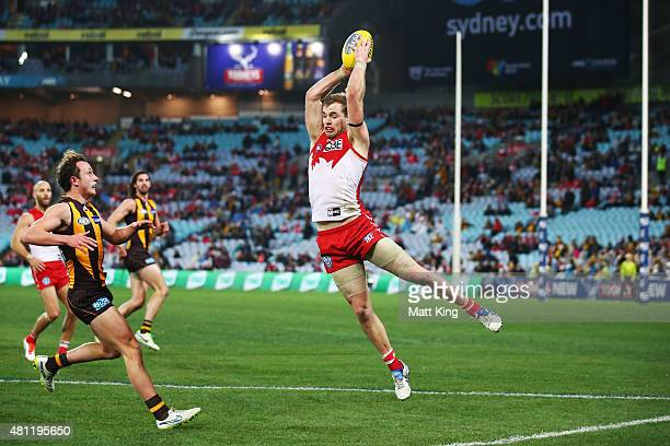 Tom Mitchell of the Swans takes a mark during the round 16 AFL match between the Sydney Swans and the Hawthorn Hawks at ANZ Stadium on July 18 2015...