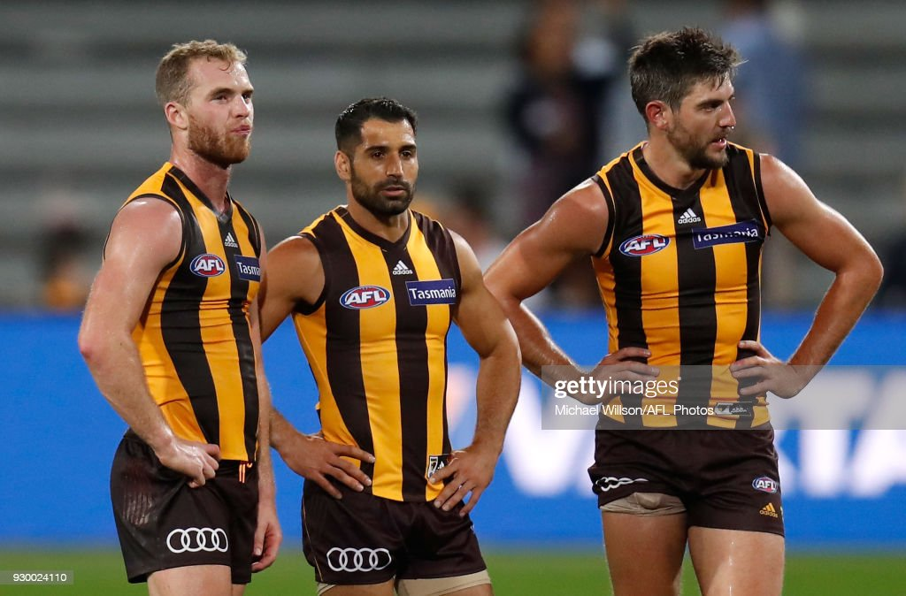 Tom Mitchell, Paul Puopolo and Ricky Henderson of the Hawks look dejected after a loss during the AFL 2018 JLT Community Series match between the Hawthorn Haws and the Carlton Blues at UTAS Stadium on March 10, 2018 in Launceston, Australia.