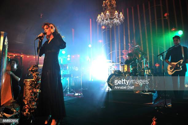 Tom Monger Florence Welch Christopher Lloyd Hayden and Robert Ackroyd perform on stage at the launch party for the new album 'Lungs' at The Rivoli...
