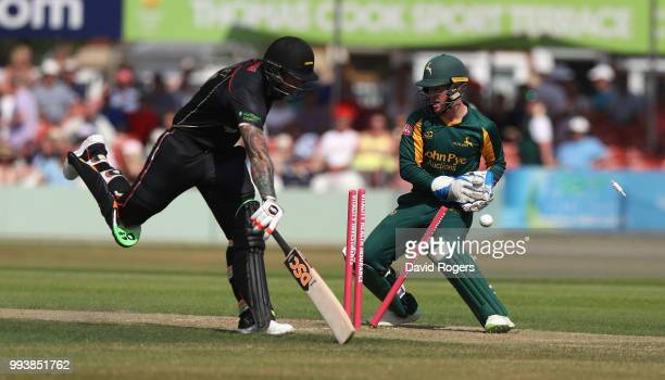 Tom Moores of Nottinghamshire attempts to run out Cameron Delport during the Vitality Blast match between Leicestershire Foxes and Nottinghamshire...