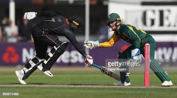 Tom Moores of Nottinghamshire attempts to run out Mohammad Nabi during the Vitality Blast match between Leicestershire Foxes and Nottinghamshire...