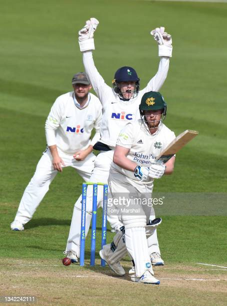 Tom Moores of Nottinghamshire bats as Harry Duke of Yorkshire makes an appeal during the LV= Insurance County Championship match between...