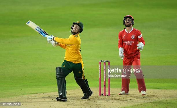 Tom Moores of Notts Outlaws hits runs watched on by Alex Davies of Lancashire during the Vitality T20 Blast Semi Final between Notts Outlaws and...