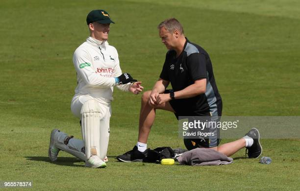 Tom Moores the Nottinghamshire wicketkeeper receives attention to an injured finger during day four of the Specsavers County Championship Division...