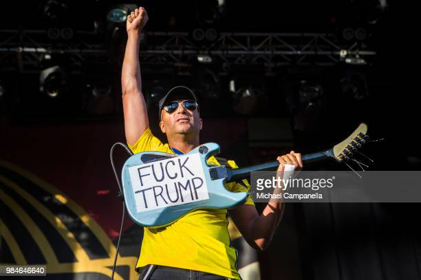 Tom Morello of the band Prophets of Rage shows a sign that reads 'Fuck Trump' while performing in concert at Grona Lund on June 26 2018 in Stockholm...