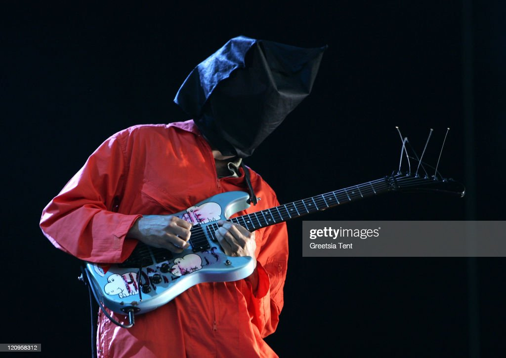 Tom Morello of the band Rage Against The Machine dresses up as Guantanamo Bay prisoners, in orange jumpsuits and black hoods in protest to the US Government, while performing the song 'Bombtrack' live on day 3 of the 39th Pinkpop Festival on June 1, 2008 in Landgraaf, Netherlands.