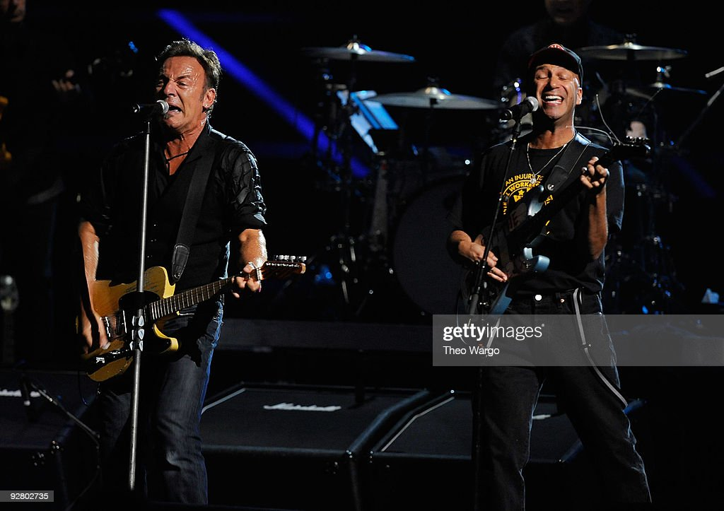 Tom Morello (R) performs onstage with Bruce Springsteen and the E Street Band at the 25th Anniversary Rock & Roll Hall of Fame Concert at Madison Square Garden on October 29, 2009 in New York City.