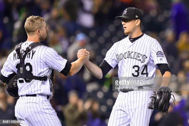 Tom Murphy and Jeff Hoffman of the Colorado Rockies celebrate the end of a 160 win over the San Diego Padres at Coors Field on September 16 2017 in...