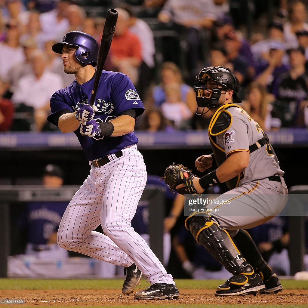 Tom Murphy #30 of the Colorado Rockies hits a home run as catcher Francisco Cervelli #29 of the Pittsburgh Pirates watches at Coors Field on September 21, 2015 in Denver, Colorado. The Pirates defeated the Rockies 9-3.