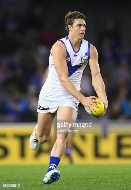 Tom Murphy of the Kangaroos kicks during the round 14 AFL match between the Western Bulldogs and the North Melbourne Kangaroos at Etihad Stadium on...
