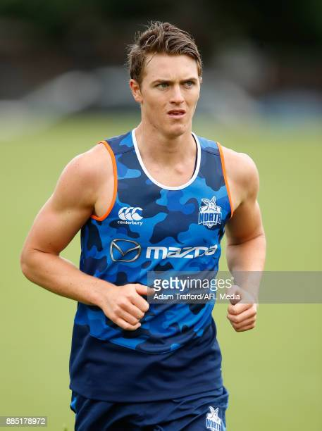 Tom Murphy of the Kangaroos runs the yoyo test during the North Melbourne Kangaroos training session at Arden St on December 4 2017 in Melbourne...