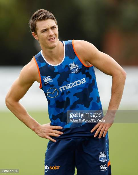 Tom Murphy of the Kangaroos stretches during the North Melbourne Kangaroos training session at Arden St on December 4 2017 in Melbourne Australia
