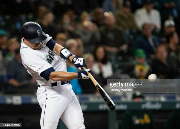 Tom Murphy of the Seattle Mariners hits a single in the second inning against the Oakland Athletics at TMobile Park on May 14 2019 in Seattle...