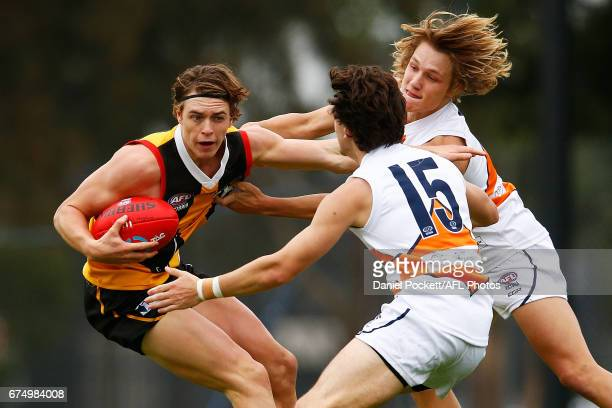 Tom Murphy of the Stingrays and Patrick Brookes of the Cannons contest the ball during the round five TAC Cup match between Dandenong and Calder at...